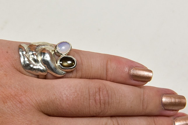 Anniversary moonstone and star saphire ring worn by the client