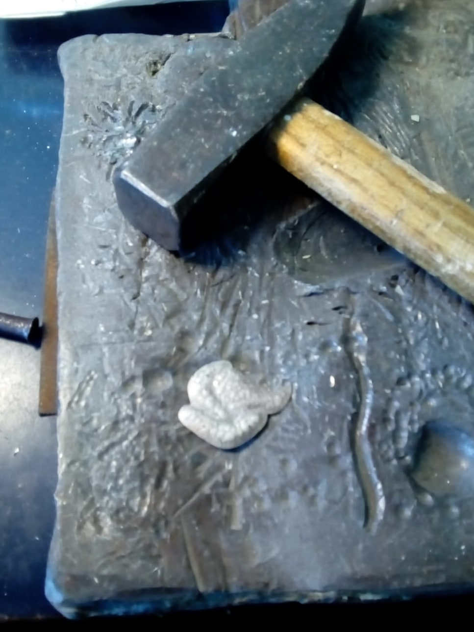 Tara Lois Jewellery chasing silver design on lead