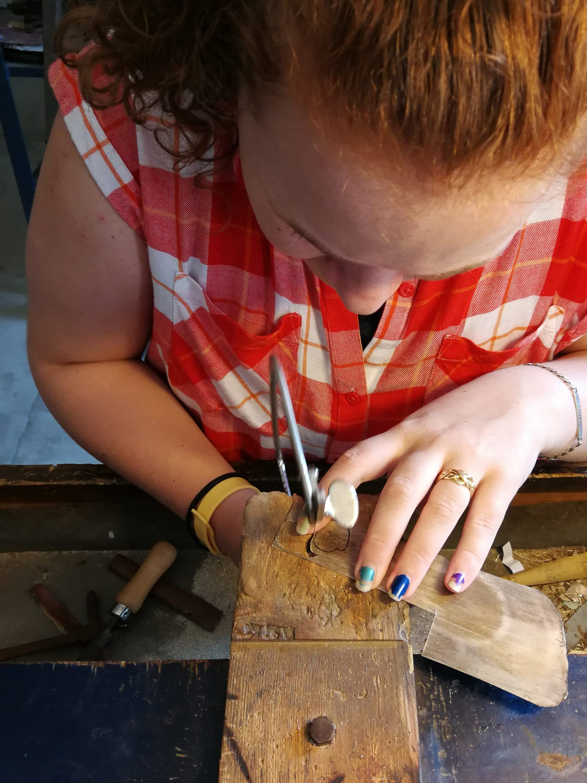 Tara Lois Jewellery cutting design out of silver sheet