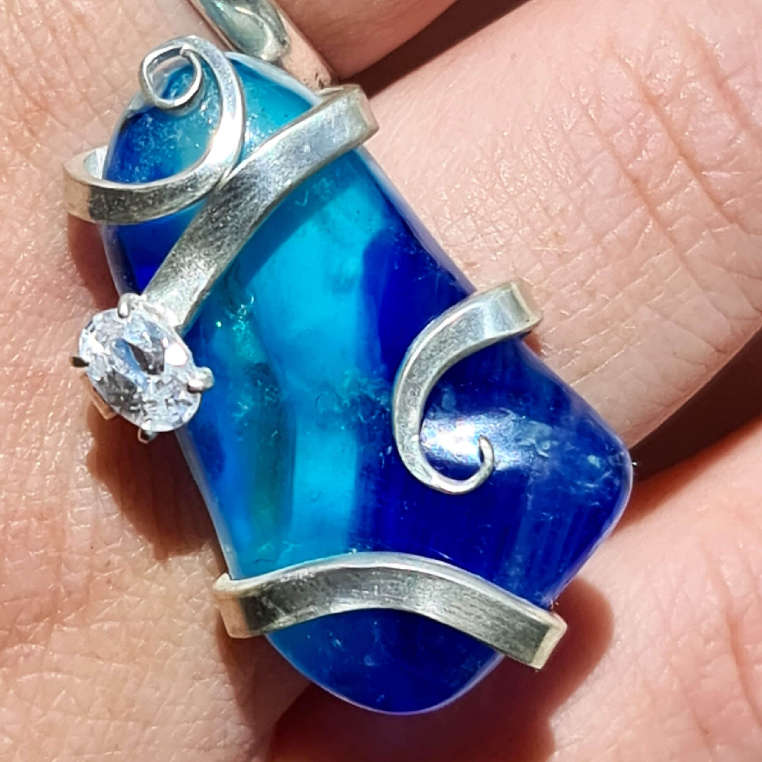 Blue glass ring with cz